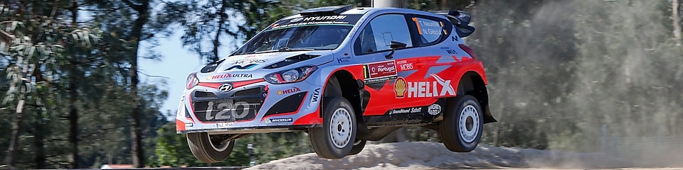 An Hyundai Shell World Rally Team car racing through a forest