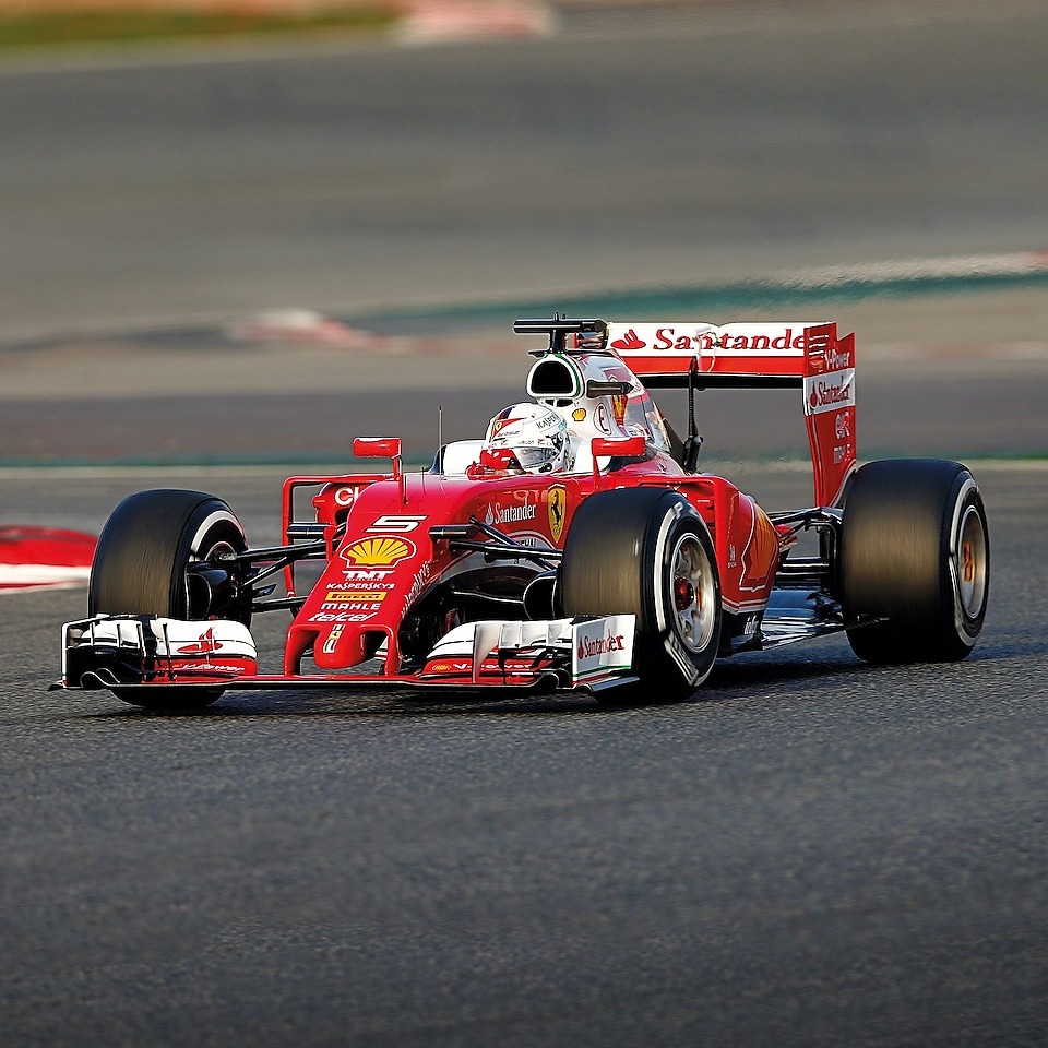 A red Scuderia Ferrari sits on a racing track, an example of Shell Helix Ultra's Innovation Partnership